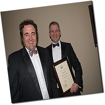 Bryan Hindle (right),  shows off Brick-Tie Preservation's training award at the PCA dinner in London