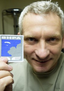 Bryan Hindle and his paragliding pilot rating badge