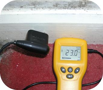 A moisture meter, testing skirting.