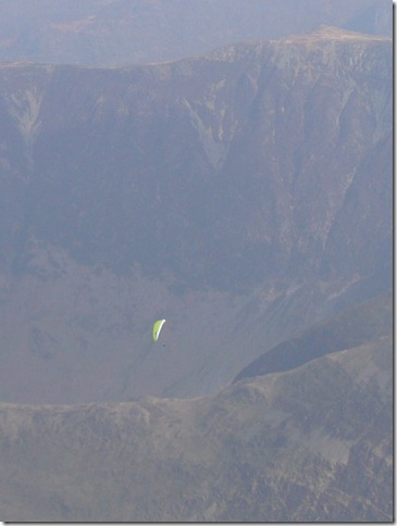 Bryan Hindle Flying above Hindscarth. High Spy behind.