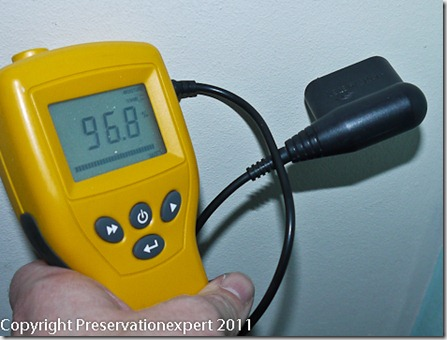 Conductivity moisture meter over-reading due to foil