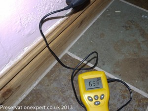 An electrical moisture meter in use