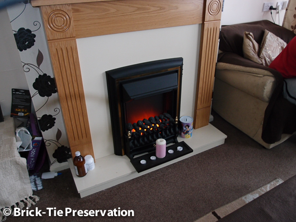 Image of an electric fire in a bricked-up traditional chimney