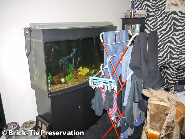 Image showing a clothes drying rack and a tropical fish tank in context of high humidity.