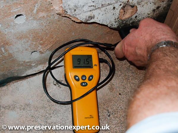Electronic protimeter moisture meter in use in Bradford